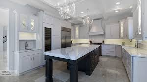 white kitchen with black island white kitchen cabinets with a grey island omega