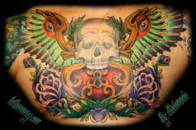 inkognito tattoos skull skull with wings chest piece tattoo