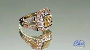 art deco design two tone gold ring with bezel set canary radiant
