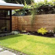 minimal modern style side yard with wood fencing studio h