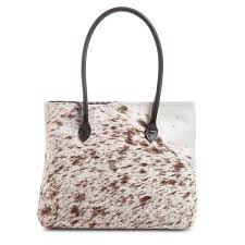 Cowhide Overnight Bag Fall In Love With Classic Cowhide Bags Cowgirl Magazine