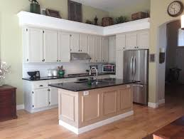 kitchen island different color than cabinets what color should we paint our kitchen cabinets