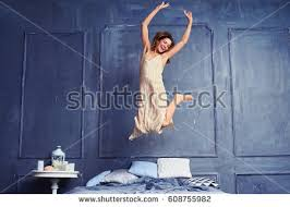 Fun In The Bedroom Low Angle Cheerful Woman Jumping On Stock Photo 613549547