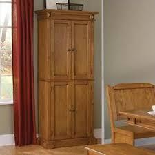 oak finish storage cabinet home styles 5004 69 americana pantry storage cabinet distressed oak