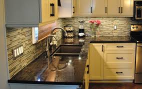 dark gray floor tile with long island white granite countertops