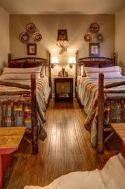 best 25 southwestern kids beds ideas on pinterest southwestern rustic log beds create a lodge feel in this bedroom while printed bed linens add southwestern decorative