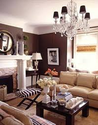 decorating with brown walls in living room with crystal chandelier