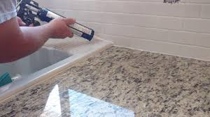 how to install silicone caulk around kitchen countertop shower