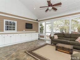 cottage family room with crown molding u0026 carpet in cary nc