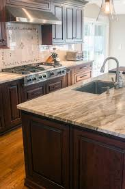 what backsplash goes with brown cabinets 50 popular brown granite kitchen countertops design ideas