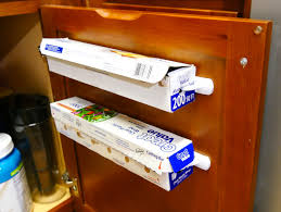 hang aluminum foil and cling wrap inside a cabinet for easier
