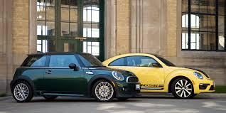 volkswagen mini two takes 2013 mini cooper s vs volkswagen beetle gsr driving