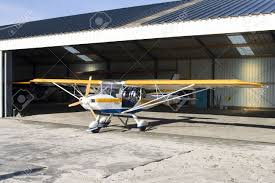 Ultra Light Airplanes Yellow And Blue Ultralight Plane In Hangar Stock Photo Picture