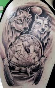dreamcatcher tattoo upper arm dreamcatcher with wolves and moon tattoo on upper arm tattooshunt com