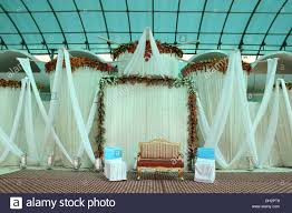 empty chairs at indian wedding reception decoration india asia
