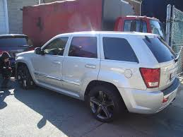 black jeep grand with black rims silver jeep srt with black wheels dnccustomz