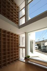 takuro yamamoto architects completes house with 30 000 books in tokyo