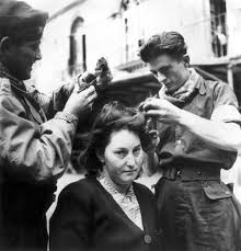 women haircutting in prison c mourning the ancient