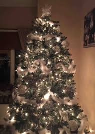 trees decorated in white and silver birthday decoration