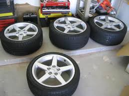 c6 corvette wheels plus billet adapters if you a gto