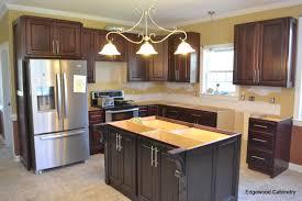 granite overhangs edgewood cabinetry