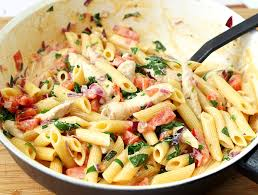 and bacon pasta with spinach and tomatoes in garlic cream sauce