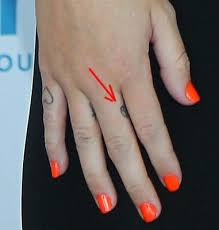 finger tattoo peace miley cyrus peace tattoo meaning and story behind the peace sign tat