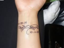 memorial style little black ink lettering with date tattoo on