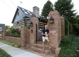 man finds out small house is actually 300 year old log cabin