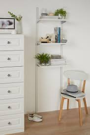 40 best all white interiors images on pinterest white interiors style open white shelving with your favourite items pile books add photo frames and