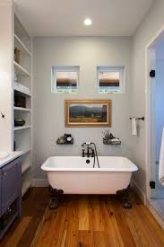 bathroom bathroom windows with claw foot tub and towel rack also