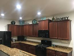 how to decorate the top of kitchen cupboards top kitchen cabinet decor ideas page 1 line 17qq