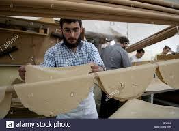 matzo unleavened bread orthodox jews kneading matzo dough in a bakery for traditional