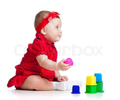 boy model richie set funny little child playing with cup toys isolated over white