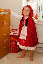 little red riding hood halloween costume toddler trying a little red riding hood costume before halloween stock