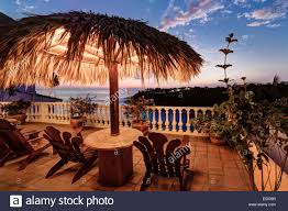 view from a patio of the hotel villas carrizalillo at twilight in