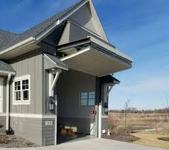 16 ft tall rv garage door has ingenius design to appear half its