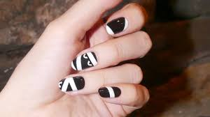 an easy halloween nail art tutorial coveteur