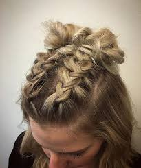 2 braids in front hair down hairstyle long natural hair double dutch braids finished into buns for this cute concert goer