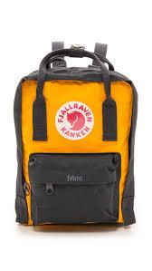fjallraven kanken mini backpack navy warm yellow in yellow lyst