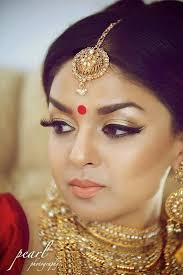 light yet flawless gorgeous makeup indian bride wearing bridal jewelry indianbridalhairstyle indianbridalmakeup
