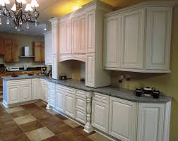 white kitchen cabinets with white and grey countertops 10 antique white kitchen cabinets that jazz your kitchen up