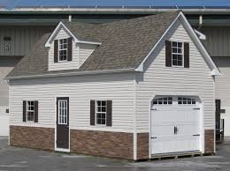 Beautiful Appearance Stone Vaneer Gives This Garage A Beautiful Appearance Two Story