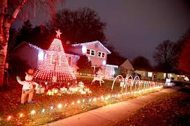 christmas light display synchronized to music five homes in rolling meadows are stopping traffic