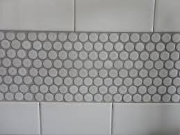 white penny round tile with grey grout round designs