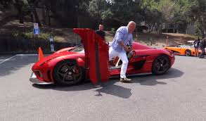 koenigsegg red christian von koenigsegg in his new regera