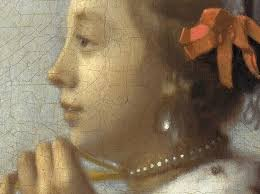 vermeer pearl necklace why is the girl with a pearl earring wearing a silver earring