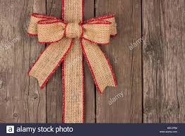 rustic ribbon burlap christmas bow and ribbon side border above view on a