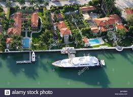 luxurious homes on hibiscus island with yacht real estate miami stock photo luxurious homes on hibiscus island with yacht real estate miami florida united states of america usa