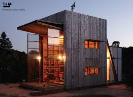 simple orange house exterior paint idea with white window frames
